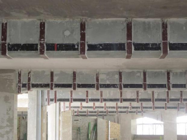 Verstärkung der Unterzüge mit Sto S&P CFK Lamellen und Stahllaschenbügeln